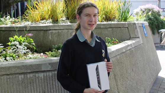 Pictured: iPad mini winner Capril Mawston with her prize.