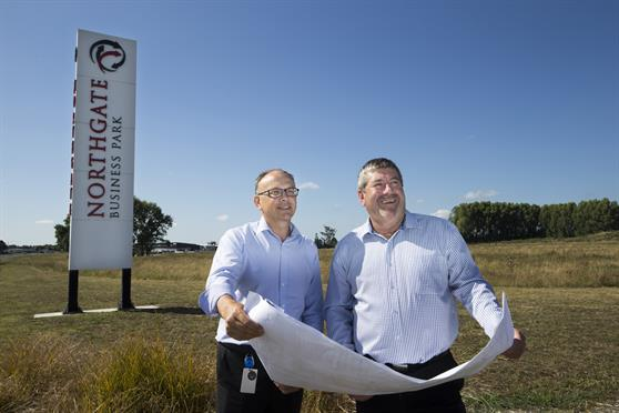 Clive Morgan and Mayor Allan Sanson with the plans for the new hub. Photo by Peter Drury
