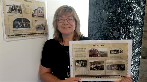 Library coordinator Maria Cleland pictured with the heritage posters at Huntly Library and Council Office.
