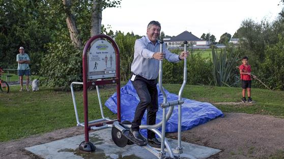 Waikato District Mayor Allan Sanson tries the new fitness trail cycle strider