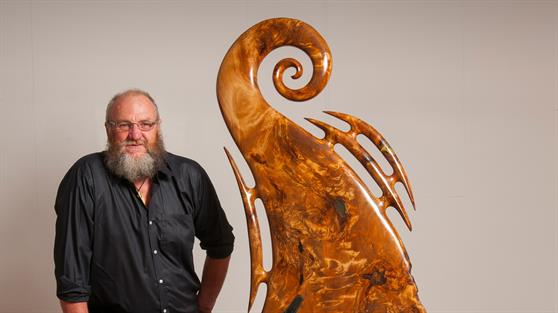 Wayne Ross with his sculpture, Inanga,  which is on display in the Waikato District Council's foyer during Matariki.